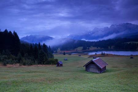 hut on meadows by Geroldsee lake, Bavarian Alps, Germany photo
