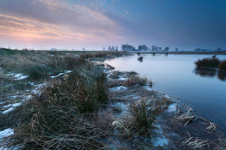 winter sunrise over river, Onlanden, Drenthe, Netherlands photo