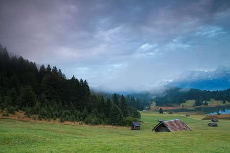 misty sunrise on alpine meadows, Bavaria, Germany photo