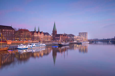Bremen city by river at sunset, Germany