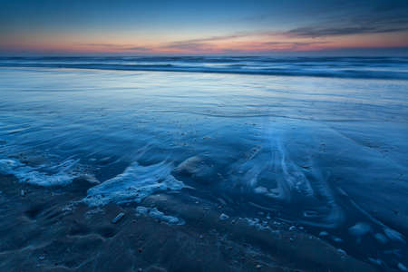 north holland: beach on North sea in dusk, Zandvoort aan Zee, North Holland, Netherlands