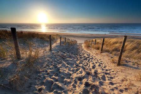 sunshine over path to beach in North sea, Zandvoort, North Holland, Netherlands Stockfoto