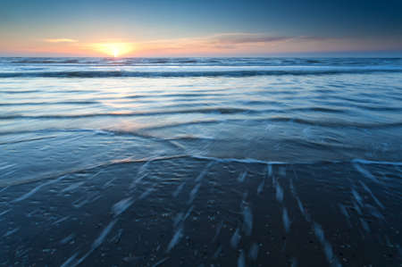 north holland: sunset over North sea waves, North Holland, Netherlands Stock Photo
