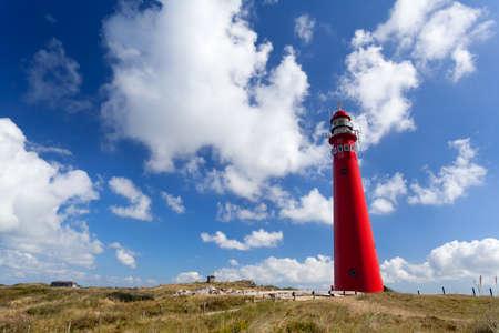 red lighthouse oer blue sky, Schiermonnikoog, Friesland Banco de Imagens