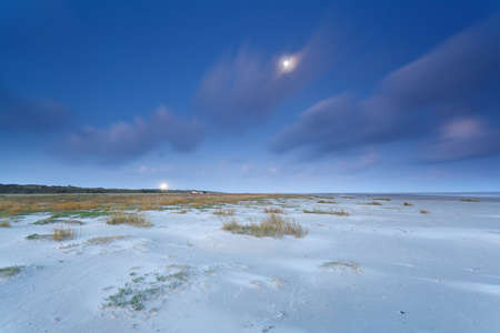 North sea coast in dusk and full moon, Netherlands photo