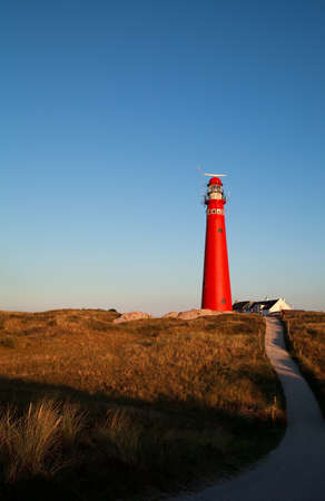 sulight: path to red lighthouse before sunset, Schiermonnikoog, Netherlands