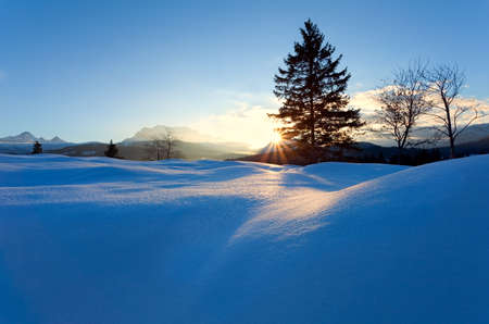 sunset over snow hills in Alps, Bavaria, Germany photo