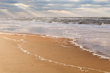north holland: sunbeams over North sea beach, Zandvoort, North Holland, Netherlands