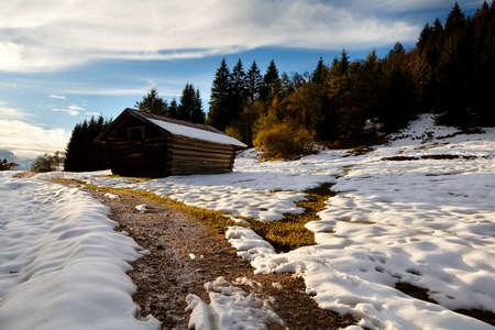 alpine hut: wooden alpine hut in sunset light, Bavaria, Germany