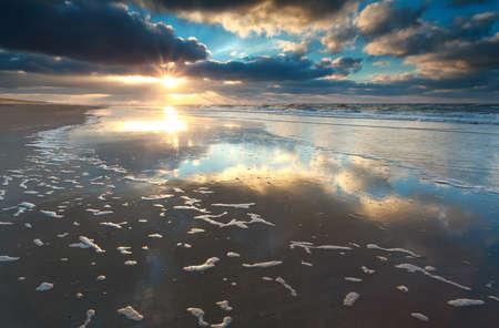gold sunset over North sea coast, Netherlands Stock Photo