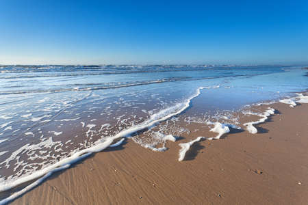 North sea sand beach and blue sky, North Holland, Netherlands