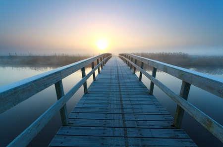 bike bridge to sunrise sun, Netherlands