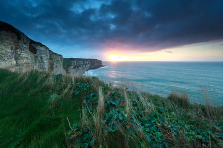 atlantic: sunset over Atlantic ocean rocky coast, France Stock Photo