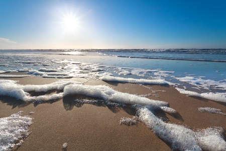 sunshine over North sea beach, North Holland, Netherlands