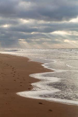 north holland: sunbeams over North sea beach, North Holland, Netherlands Stock Photo