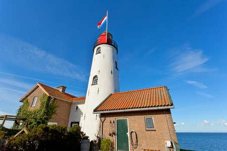 white old lighthouse in Urk, Flevoland, Netherlands Banco de Imagens