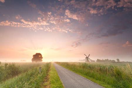 beautiful sunrise on Dutch farmland with windmill, Holland