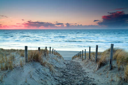 sunset over North sea sand beach, Holland