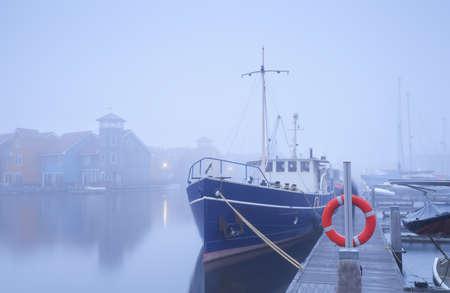 groningen: ship on harbor in dense fog, Groningen, Netherlands