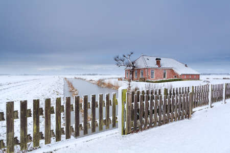 dutch: Dutch farmhouse in white snow, Netherlands