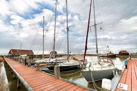 yachts on harbor in Hindeloopen, Friesland, Netherlands Stock Photo