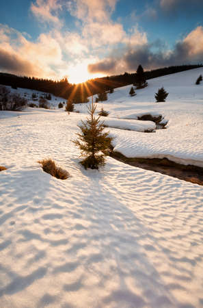 sun down: sun down over mountain river in winter, Germany Stock Photo