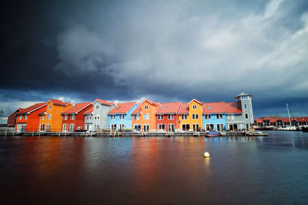 groningen: beautiful colorful buildings on water at storm, Groningen, Netherlands