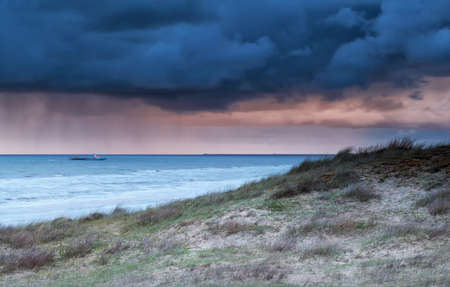 north holland: ship in North sea at storm, Zandvoort, North Holland, Netherlands