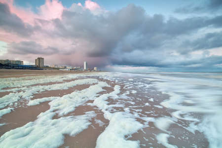 north holland: morning shower at North sea beach in Zandvoort aan zee, North Holland, Netherlands Stock Photo