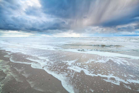 the netherlands: beautiful showery sky over North sea , Netherlands