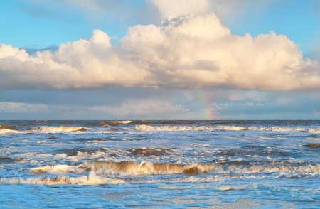 north holland: rainbow over stormy North sea, North Holland, Netherlands Stock Photo