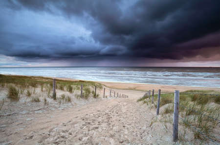 north holland: showers rolling over north sea at sundown, North Holland, Netherlands Stock Photo