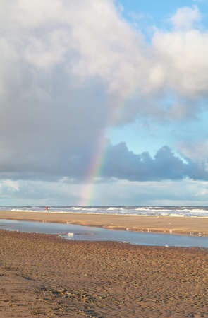 north holland: rainbow over north sea beach, North Holland, Netherlands Stock Photo