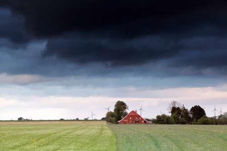 dutch: stormy clouds over Dutch farmland, Netherlands