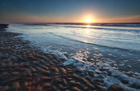 summer sunset on North sea beach, Holland Stock Photo