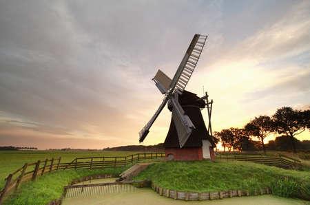 Dutch windmill at sunrise, Holland Stock Photo
