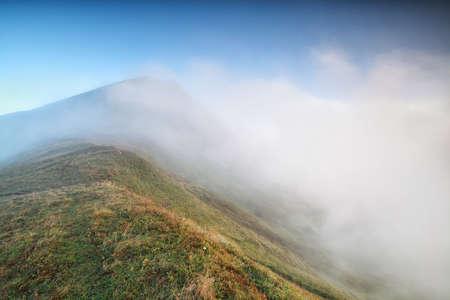 mountaintop: morning fog around mountaintop in Alps, Austria Stock Photo
