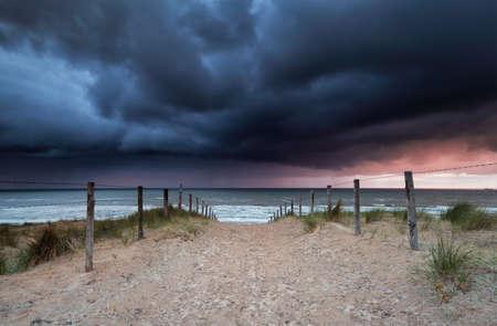 stormy sunset over beach in North sea, Zandvoort aan zee, Netherlands Stock Photo