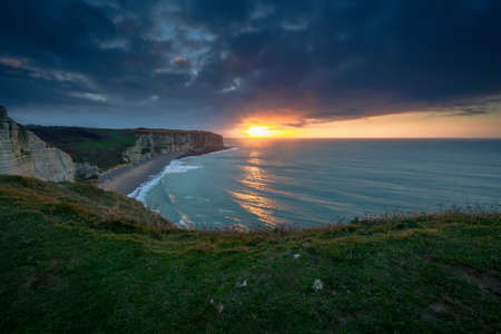 normandy: sun rays over Atlantic ocean waves, Etretat, France