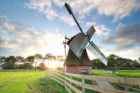 beautiful sunrise behind Dutch windmill