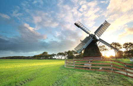 holland windmill: charming Dutch windmill  ats sunrise