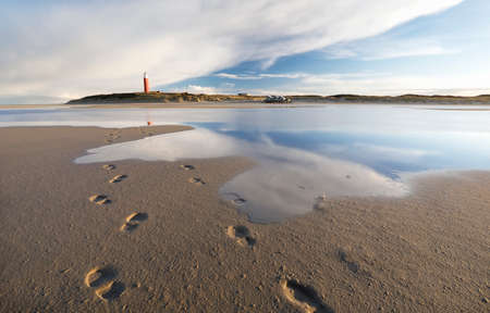 blue sky reflected in sea water on beach, Texel, Netherlands Stockfoto