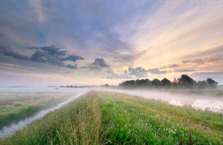foggy morning along river, Netherlands