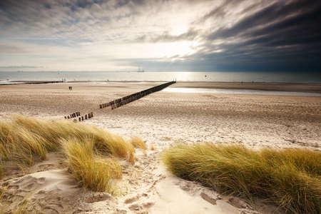 sunshine over North sea sand beach, Vlissingen, Netherlands