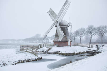 Dutch windmill in snow during winter
