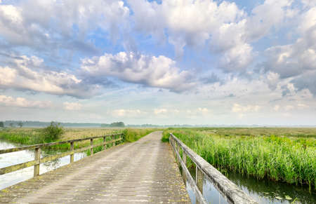 beautiful clouds over bridge and river in summer