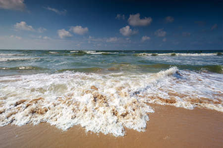 beautiful beach with North sea waves on sunny day Banco de Imagens