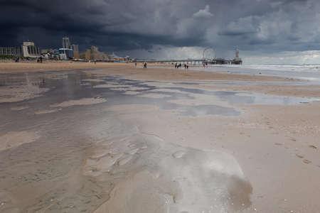 dramatic stormy sky over North sea beach in the Hague Banco de Imagens