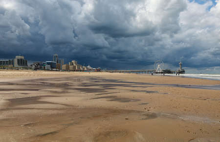 dramatic storm sky over sand beach in the Hague, Holland Banco de Imagens