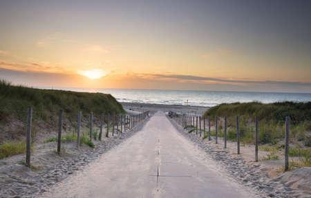 path to North sea beach at sunset Banco de Imagens